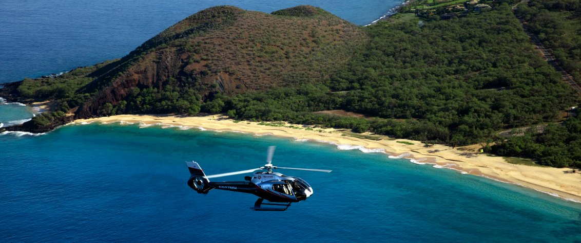 Take a Helicopter Flight Around the Island When You First Arrive