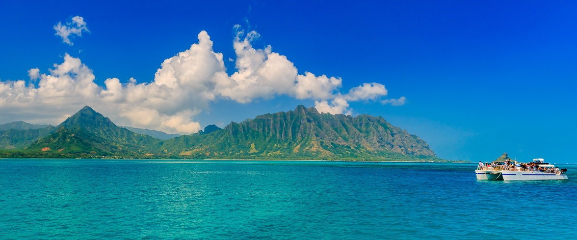 Enjoy seeing Oahu from a sightseeing boat.