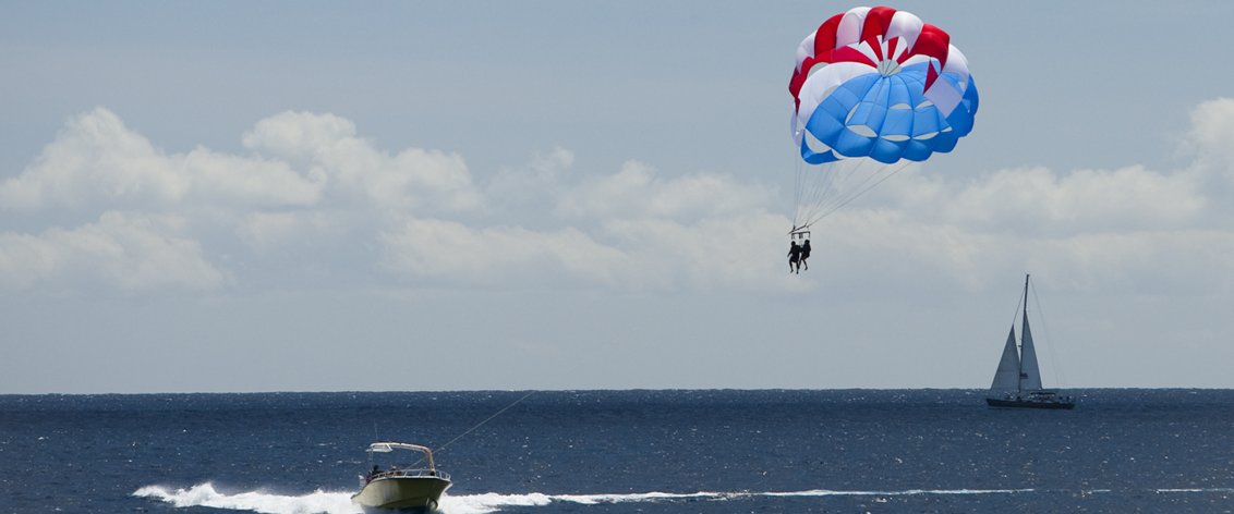 Parasailing in Hawaii is fun for the whole family.