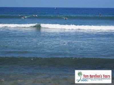 Surfers Enjoying The Waves At Puamana